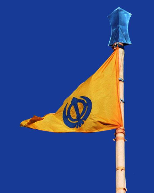 What is the saffron flag (Nishan Sahib) on the Gurdwara?